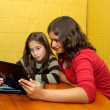 Young girls with laptop — Stock Photo