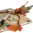 Travel diary with a pen and feathers — Stock Photo