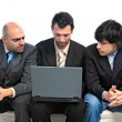 Businessmen with laptop — Stock Photo