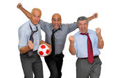 Businessmen playing soccer — Stock Photo