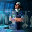 Stock Photo: Doctor with screens