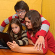Young girls and boy with laptop — Foto Stock