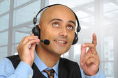 Businessman with headset — Photo