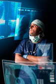 Doctor with screens — Stock Photo