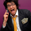 Hansome young man with phone — Stock Photo #23579995