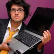 Young man with laptop — Stock Photo #23580021