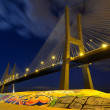 Vasco da Gama Bridge by night - Stock Photo
