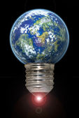Lightbulb with planet — Stock Photo