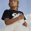 Stock Photo: Boy with skim-board