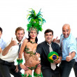 Businessmen and brazilian carnaval dancer with soccer ball — Stock Photo