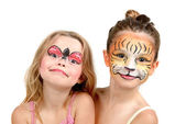 Face painting, tiger and ladybug — Stock Photo
