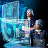 Doctors with screens — Stock Photo