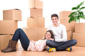 Happy couple with boxes — Stock fotografie