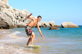 Teenager surfing — Stock Photo