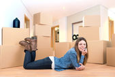 Girl with boxes — Stock Photo