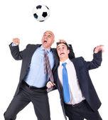 Businessmen playing soccer — Stockfoto