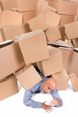 Businessman under boxes — Stock Photo