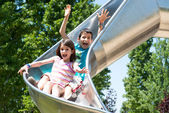Kids in the slider — Stock Photo