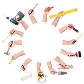 Mani con strumenti di costruzione — Foto Stock