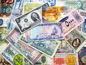 Banknotes of different national currencies — Stock Photo
