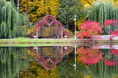 Autumn park reflection in the water — Stock Photo