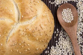 Sesame bread with sesame seed in wooden spoon — Стоковое фото