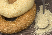 Close-up two types of bagel with sesame seeds in spoon  — Stock Photo