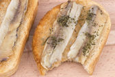 Sandwiches with marinated fish on toast — Стоковое фото