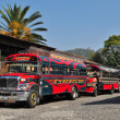 Stock Photo: Colourful chicken buses on street in Antigua, Guatemala