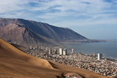 Iquique behind a huge dune, northern Chile — Stock Photo