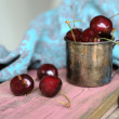 Sweet cherry in the ancient pewter mug — Stock Photo