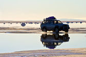 The car on the salt lake — Stock Photo