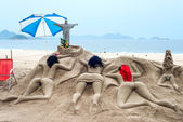 Sand sculpture sunbathe on the beach of Copacabana — Stock Photo
