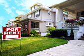 Home For Rent Sign in Front of Beautiful American House — Stock Photo