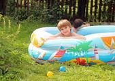 Children in swimming pool — Stock Photo