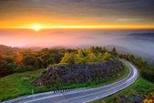 Sunrise over mountain at Doi In Thanon,THAILAND — Stock Photo
