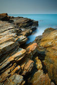 Seascape at rock beach with long exposure technic — Stock Photo