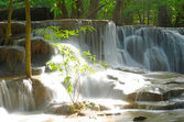 Waterfall in tropical deep forest at Huay Maekhamin — Stock Photo