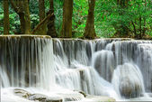 Waterfall in tropical deep forest at Huay Maekhamin — Foto de Stock