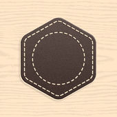 Blank leather badge in retro vintage style. Rounded hexagon shape on wood texture pattern background. Template Satisfaction Guaranteed and Premium Quality labels — Stock Vector