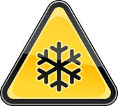 Yellow hazard sign with black snowflake low temperature symbol. Triangular glossy shape on white background. This vector illustration clip-art design element saved in 10 eps — Stock Vector