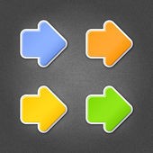 4 colored arrow sign stickers web icon. Smooth green, orange, yellow, blue internet button with drop shadow on gray background with noise effect. This vector illustration design element saved 10 eps — Stock Vector
