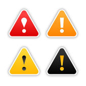 Four warning stickers with exclamation mark sign and drop shadow on white background — Stock Vector