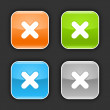 Colored glossy rounded square buttons with delete sign with shadow on gray. 10 eps — Stockvektor