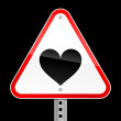 Triangular red road warning sign with heart symbol on black background — Stock Vector