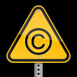 Yellow road hazard warning sign with copyright symbol on a black background — Stock Vector