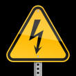 Yellow road warning sign with high voltage symbol on black background — Stock Vector