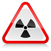 Red attention warning sign with radiation symbol on white — Stock vektor
