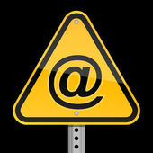 Yellow road hazard warning sign with commercial at symbol on a black background — Stock Vector