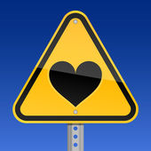 Yellow road hazard warning sign with heart symbol on a black background — Stock vektor